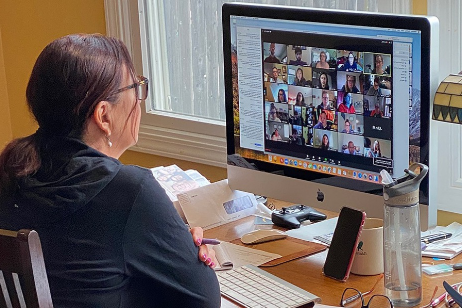 Elizabeth Collucci participates in a Zoom meeting with her colleagues.