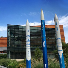 Three rockets built by UB SEDS club in front of Davis Hall.