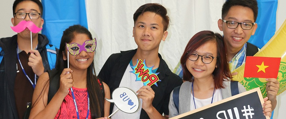 Students posing in a photobooth.