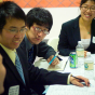 Students conversing around a table.