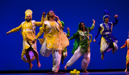 Artists dancing on stage.