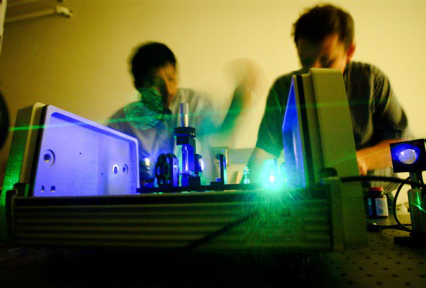 working with lasers in lab.