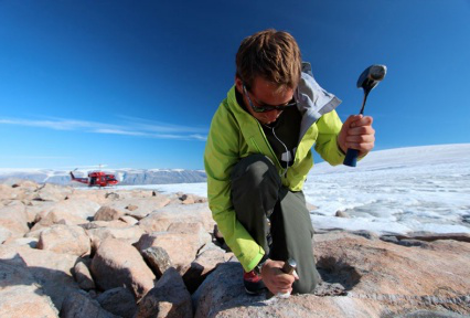 researcher collecting rock samples.