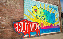 Buffalove mural painted in bright colors on a brick wall.