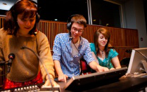 An image of students operating a theatre control board.