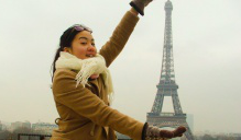 Student from study abroad program in Paris near the Eiffel tower.