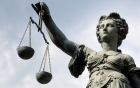 Photo of a female statue holding the scales of justice.